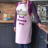 "A personalised light pink apron with a photo of a child and the words ""Best Mummy Ever"" printed on it"