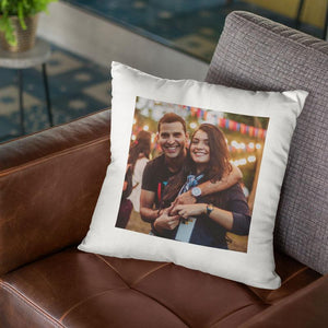 A personalised white cushion with a photo of a couple printed on it