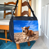 A black messenger bag with a photo printed on the front