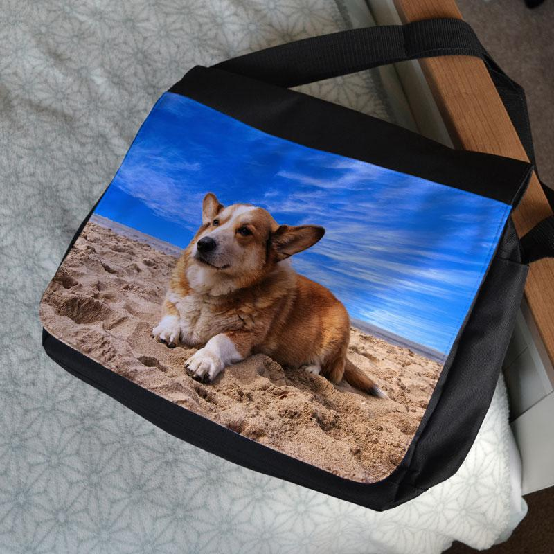 A personalised messenger style satchel with a photo printed on it