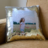 A personalised gold reveal cushion with a photo printed onto it