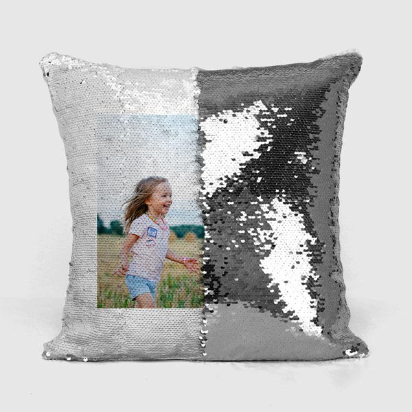A silver personalised reveal cushion with a photograph of a little girl printed on it