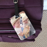 A luggage label featuring a family photo, the luggage label is attached to a suitcase