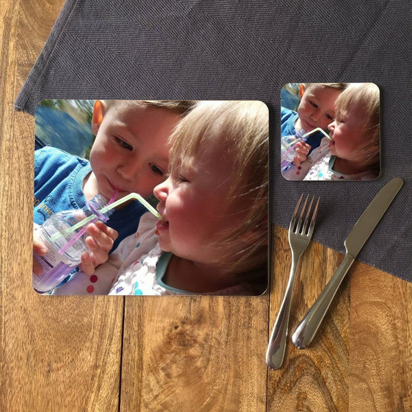 A personalised rectangle placemat with a photo of 2 children printed onto it