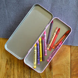 The inside of a personalised pencil tin showing the room for pencils and pens