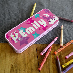 A personalised pink pencil tin with a cartoon unicorn design printed on the lid