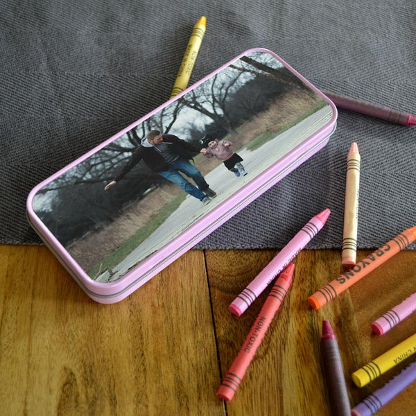 A personalised pink pencil tin with a photo of a dad and daughter printed on the lid