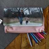 A personalised pink pencil case with a photo of a dad and daughter printed on the front.