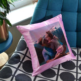 A personalised pink cushion with a photo of a dad and daughter printed on it.