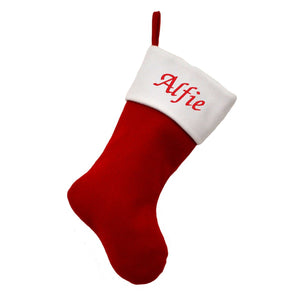 "A personalised Christmas stocking in the classic Christmas red with a white top. The top of the stocking is personalised with the name ""Alfie"" in red lettering on the white background."