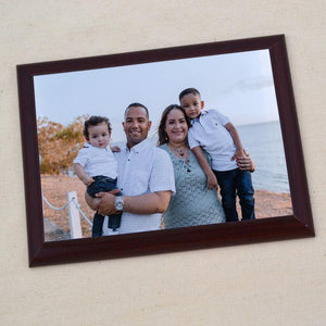 A personalised wooden plaque with a family photo printed on it