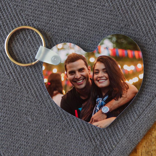 A personalised heart keyring with a photo of a couple printed on it