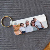 Personalised plastic rectangle keyring with a photo of a family printed on it