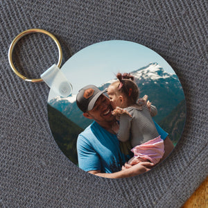 Personalised circle plastic keyring with a photo of a father and daughter printed on it