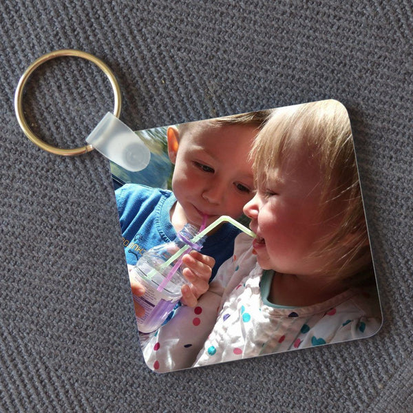 A plastic square keyring personalised with a family photo