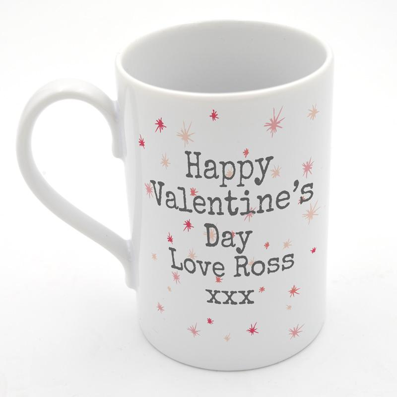 A personalised porcelain mug with a valentine's day heart design and a custom message
