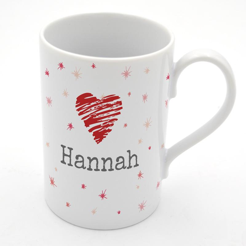 A personalised porcelain mug with a valentine's day heart design