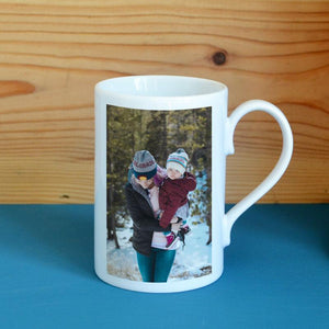 A personalised porcelain mug with a photograph of a mother and daughter printed onto it