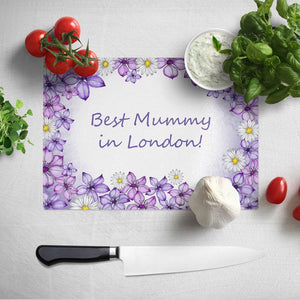 A personalised white and purple Mother's Day chopping board.