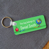 A personalised green name badge on a keyring