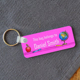 A personalised keyring name badge in pink