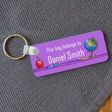 A personalised purple name badge on a keyring