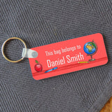 A personalised red keyring name badge