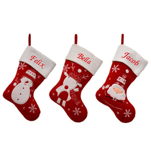 3 red and white stockings in a row, one with a snowman, one with a reindeer and one with Santa Claus on the front. The stockings have a white top which is embroidered with a red name.