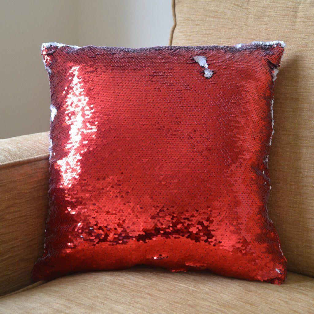 A red sequin reveal cushion with its message hidden