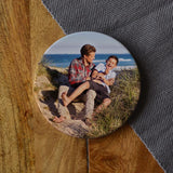 A personalised ceramic coaster with a photo of a dad and son printed on it.