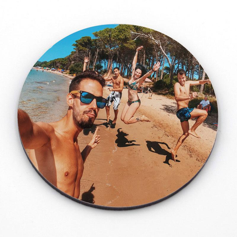 Personalised round photo coaster showing a group of friends on the beach