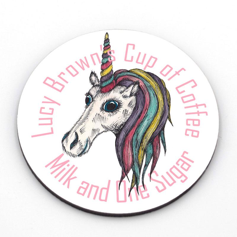 Personalised round coaster with a unicorn in the centre and custom text around the edge in pink lettering