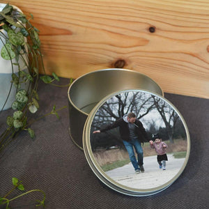 A personalised round metal photo tin