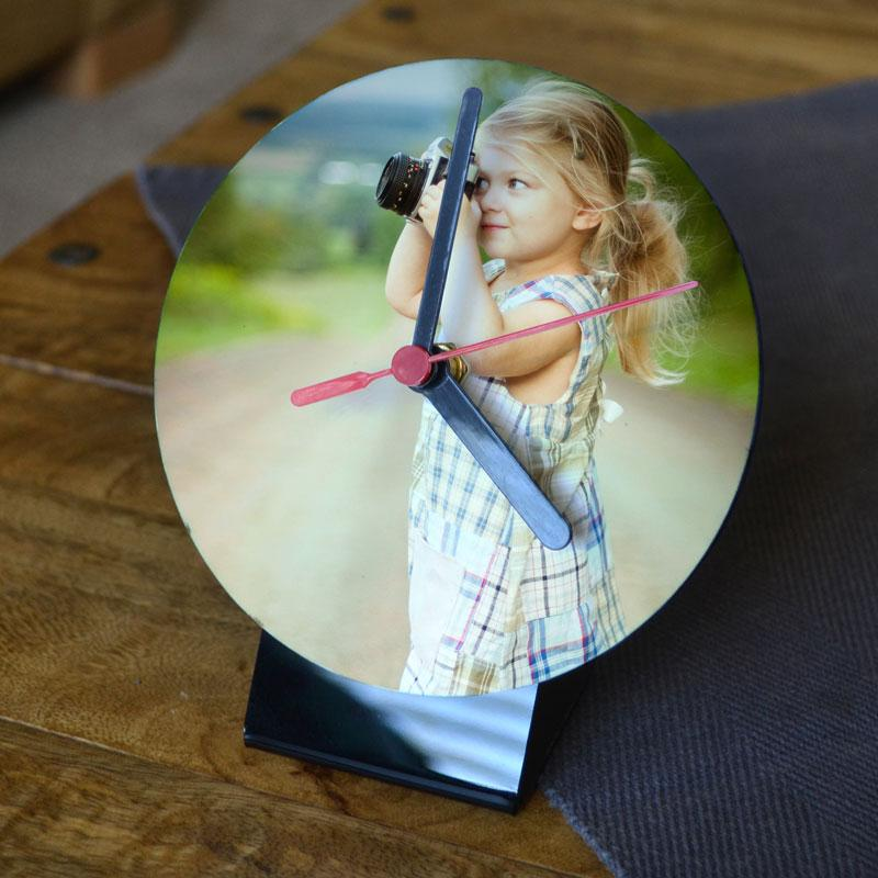 A personalised desktop clock with a photo of a little girl printed on it