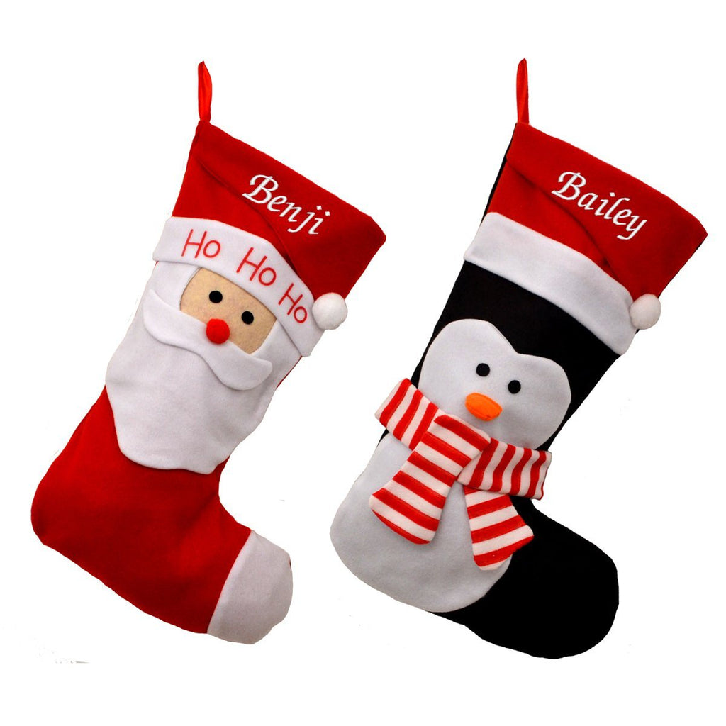 2 personalised Christmas stockings, one featuring a Santa design and one featuring a penguin design. Both are embroidered with a name in white lettering on a red background.