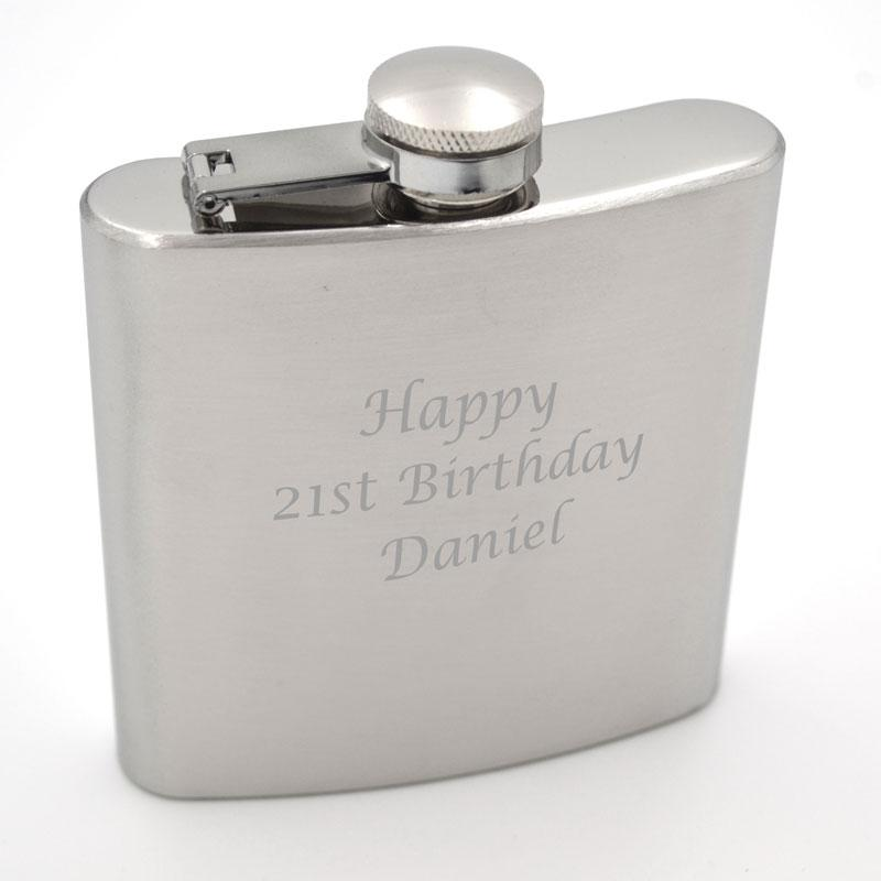A personalised hip flask with an engraved message in stainless steel