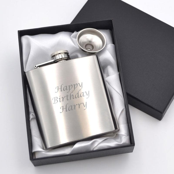 A personalised silver hip flask with an engraved message