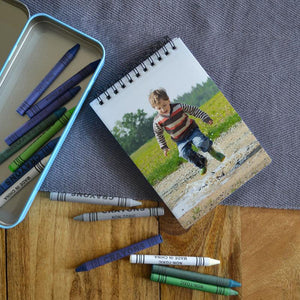 A personalised note book with a photo of a little boy printed on the cover