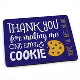 "A personalised royal blue mouse mat with an illustration of a cookie and a message saying ""thank you for making me such a smart cookie"""