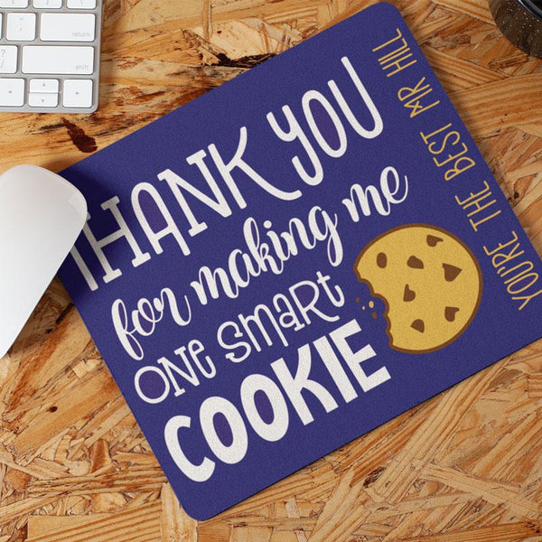 A personalised royal blue mouse mat with white lettering and an illustration of a cookie.