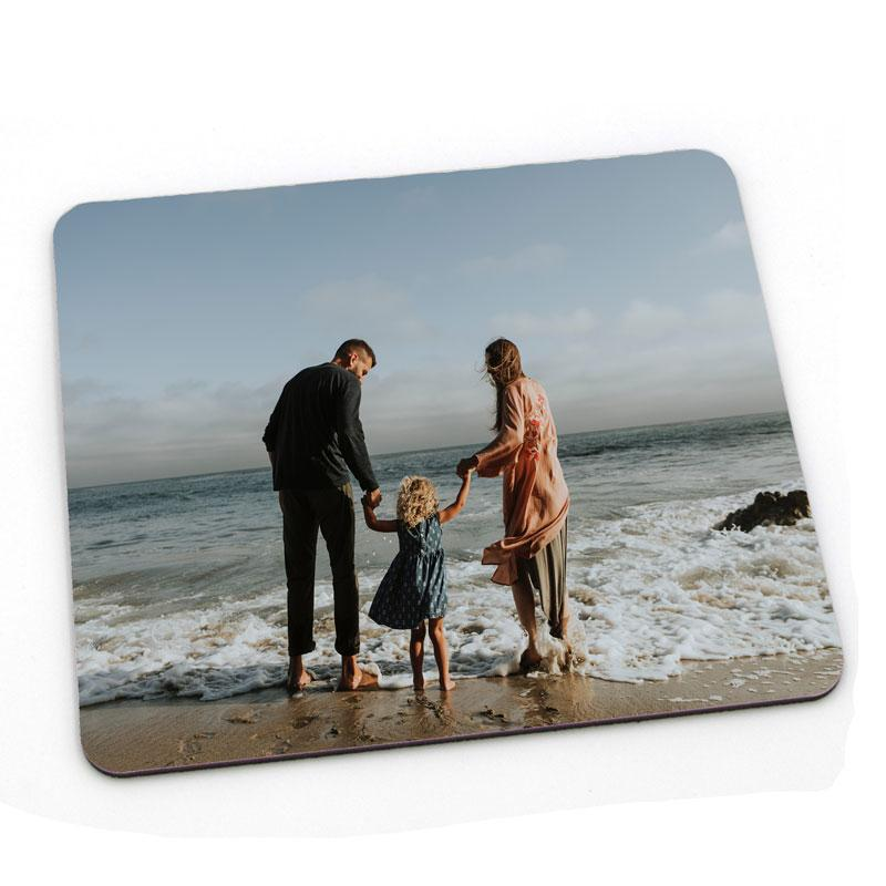 A personalised square placemat with a family photo printed on it.