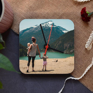 A personalised square photo clock with a photograph of a family printed on it.