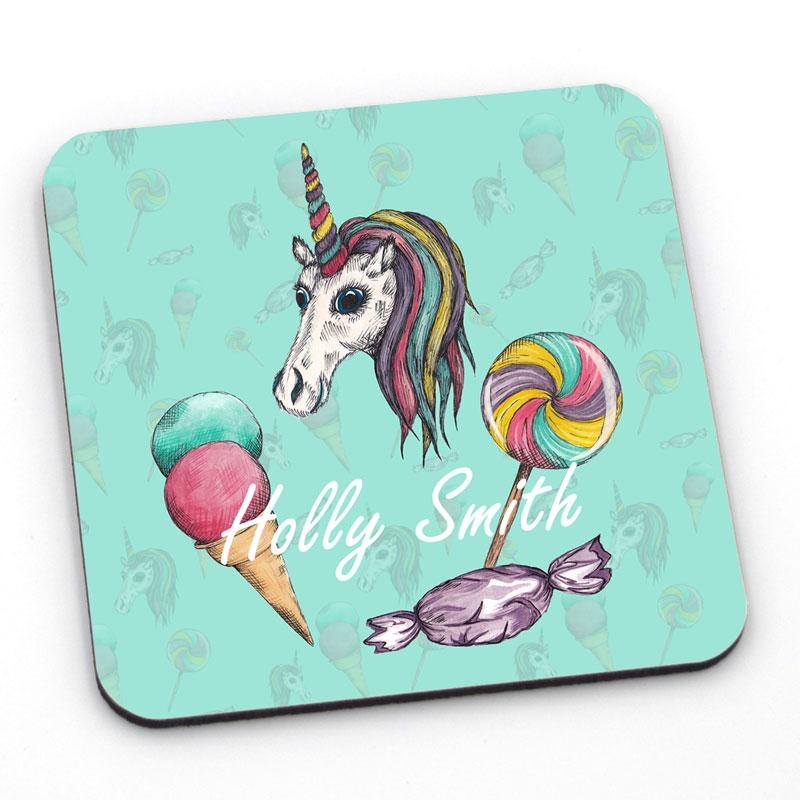 A mint green coaster with a unicorn design and personalised text