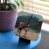 A personalised square photo desk clock