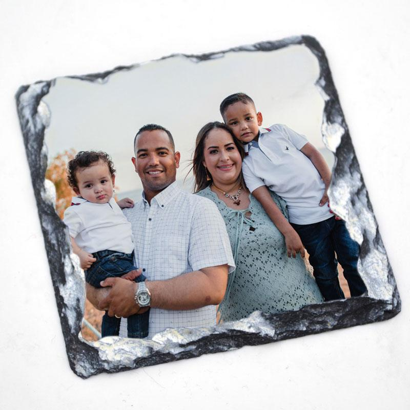 A custom square coaster made from slate with a full colour photo of a family printed on it