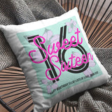 A personalised pink and mint green sweet sixteen cushion on a chair