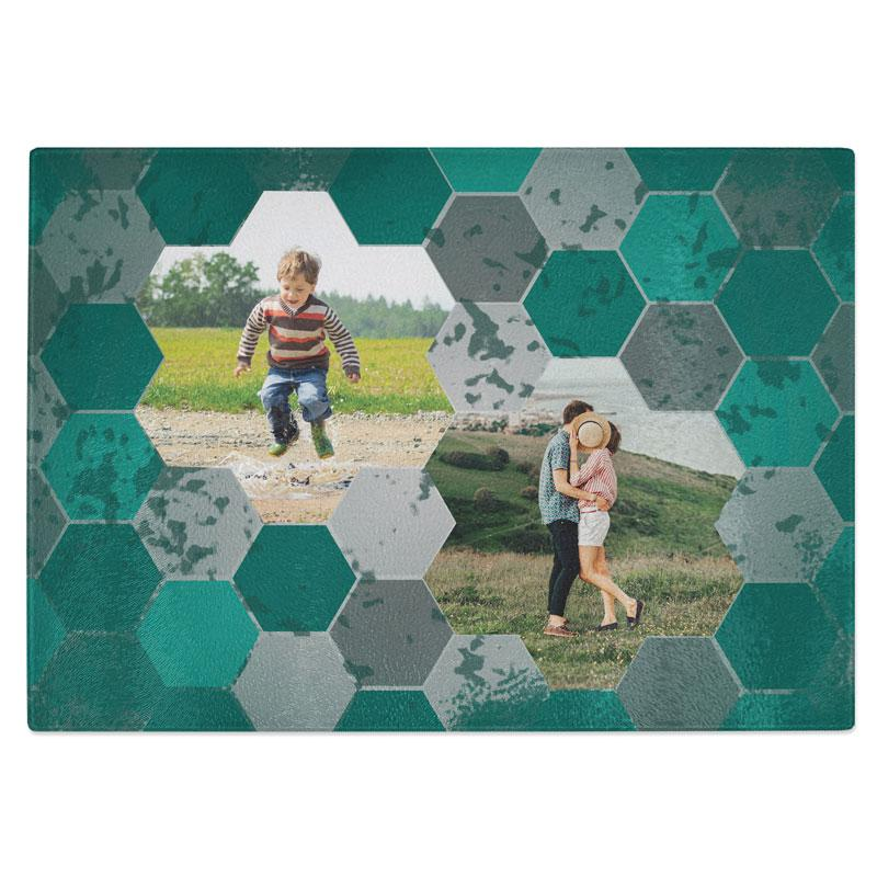 A personalised glass chopping board with two family photos and a teal hexagon pattern round the edge