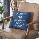 A personalised blue cushion with white lettering printed on it