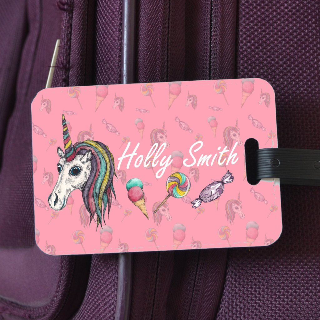 "A personalised unicorn luggage label. The design includes an illustration of a unicorn and the name ""Holly Smith"" and can be customised with your own name."
