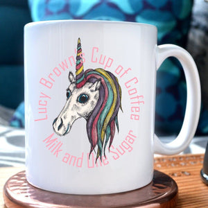 "A personalised unicorn mug with an illustration of a unicorn in the centre and the message ""Lucy Brown's cup of coffee, milk and one sugar"""